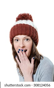 Amazed pretty young girl in winter knitted hat isolated picture