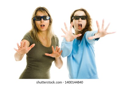 Amazed woman and girl wearing 3D glasses experiencing 5D cinema effect - wind