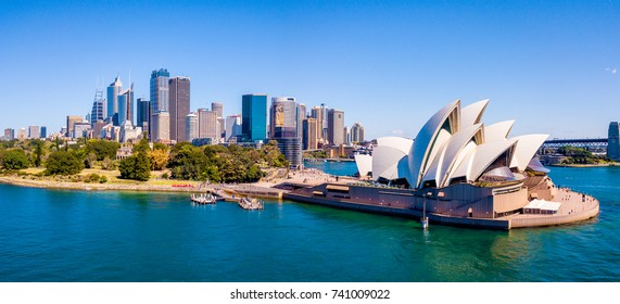 Amazing aerial footage view of the Sydney city from above with Harbour bridge, Opera house ant the harbour. April 10, 2016. Sydney, Australia.