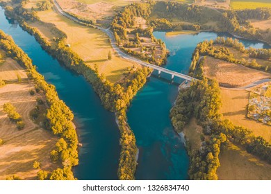 Amazing aerial landscape over a bridge crossing over two arm river