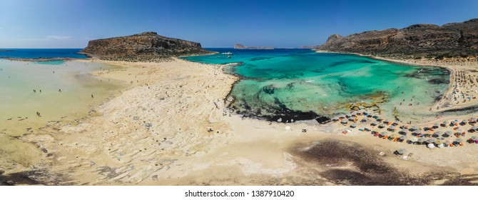 Amazing aerial panoramic view on the famous Balos beach in Balos lagoon and pirate island Gramvousa. Place of the confluence of three seas. Balos beach, Chania. Crete island. Greece. Europe.