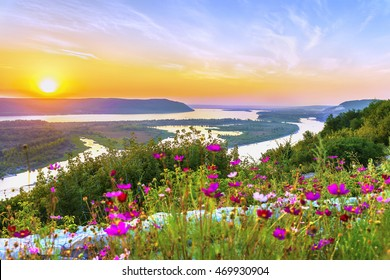 Amazing aerial panoramic view on the touristic part of the Volga river near Samara city in last rays of the sunset. Beautiful natural landscape of the Central part of Russia at summer. Europe.