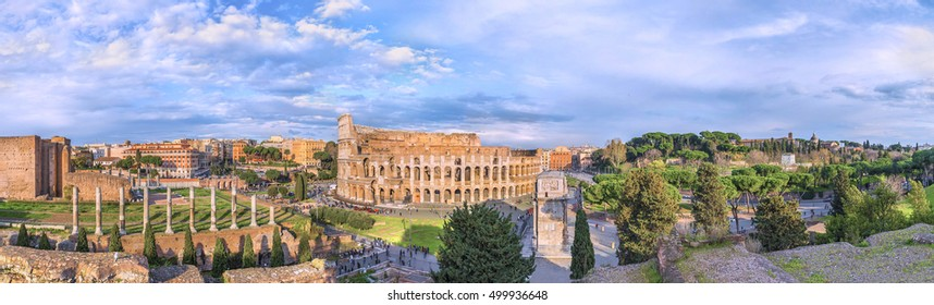 Amazing aerial panoramnic view on the Great Roman Colosseum ( Coliseum, Colosseo ,also known as Flavian Amphitheatre ) at sunset. Famous world landmark. Scenic urban landscape. Rome. Italy. Europe