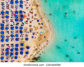 Amazing Aerial View from Above over Nissi Beach in Cyprus. Nissi Beach At high tide. Tourists relax on the beach. Crowded beach with lots of tourists. A popular place