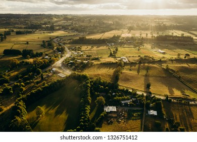 Amazing Aerial view of a field of grass and trees at sunset