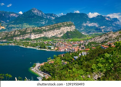 amazing aerial view on the northern part of Garda Lake with mountains and small village Torbole, Italy
