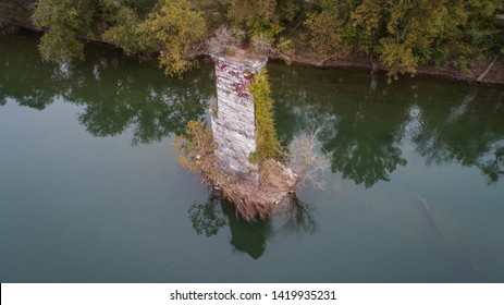Amazing Aerial View Photograph of Unusual Live Green Tree Growing on Abandoned Dilapidated Aged Stone Concrete Pillar Pedestal Ruin of Old Historical Destroyed Railroad Bridge on the Potomac River.