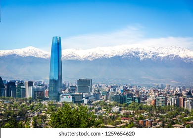 Amazing aerial view of Santiago city with the Andes range covered in snow in the background in Chile