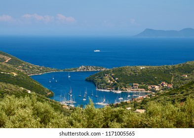 Amazing aerial view of Sivota village and it's bay - in Lefkada island in Greece. In front are the olive trees and in distance is Atokos island.