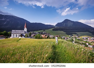 Amazing alpine scenery from Berwang, Austria. Summer landscape with green fields and Alps Mountains.