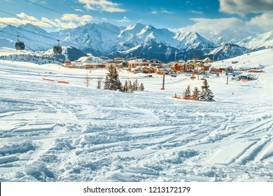 Amazing alpine ski resort with majestic ski slopes and cable cars, Alpe d Huez, France, Europe