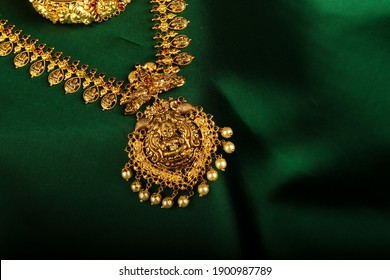 Amazing Antique Gold Jewelry placed on green silk cloth picture.