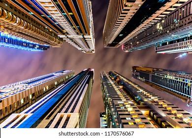 Amazing architecture parallel buildings. Cloudy night sky. Luxury travel inspiration. Dubai marina.