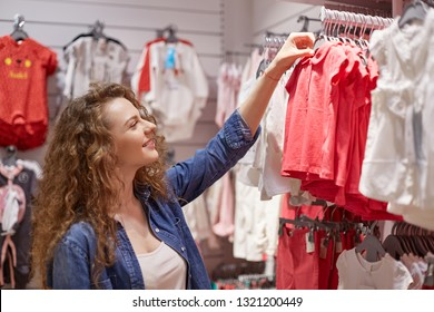 Amazing aunt choose clothes for her nephew and niece. Kids are twins whom she loved so much, because their children were not yet. Choice of small clothing made godmother fun, cute and smile.