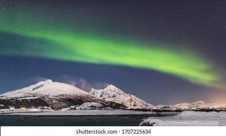 Amazing Aurora Borealis  during a cold arctic night on Lofoten Islands archipelago in winter, Norway, Scandinavia