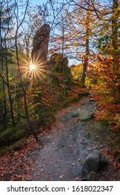 Amazing autumn day with sun and sunrays, Broumovske steny, Adrspach rocks, Czech republic - Shutterstock ID 1618022347
