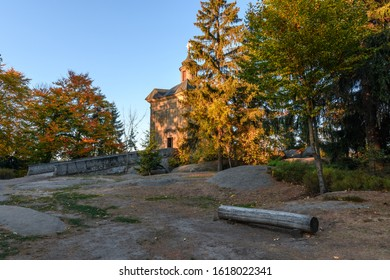 Amazing autumn of Hvezda church in Broumovske steny,  Adrspach rocks,  Czech republic - Shutterstock ID 1618022341