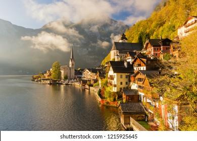 Amazing autumn view on famous Hallstatt mountain village on alpine lake in the Austrian Alps at beautiful morning light. Location place: Hallstatt, Salzkammergut, Austria.