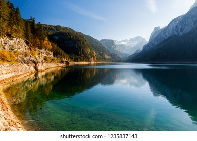 Amazing autumn view on Vorderer Gosausee Lake and Dachstein mountains with Great Gosau Glacier reflected in the water. UNESCO World Heritage. Location place: Salzkammergut region, Upper Austria.