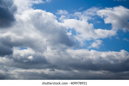 Amazing background of bright blue sky with heavy clouds