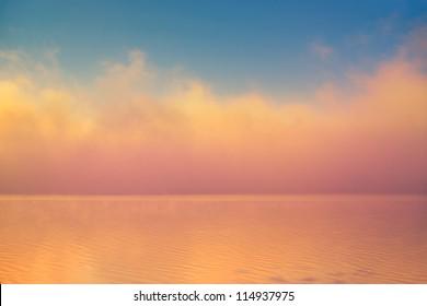 Amazing background fog cloud over river shiny wave at sunrise