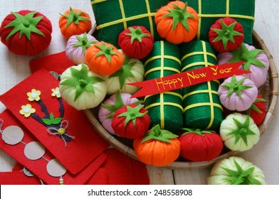 Amazing background on Tet holiday in Vietnam, banh tet, banh chung or glutinous rice cake make handmade from colorful material, harmony concept with Happy New Year message, traditional  Lunar New Year