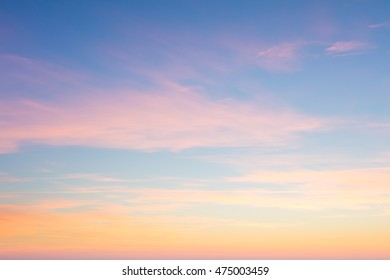 Amazing background of sunrise sky with gentle colors of soft clouds, big size