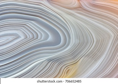 Amazing Banded Agate Crystal cross section as a background. Natural light translucent agate crystal surface, Gray abstract structure slice mineral stone macro closeup