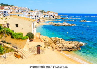 Amazing beach in Calella de Palafrugell, scenic fishing village with white houses and sandy beach with clear blue water, Costa Brava, Catalonia, Spain