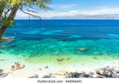 amazing beach with crystal clear water in Kassiopi in Corfu island, Greece
