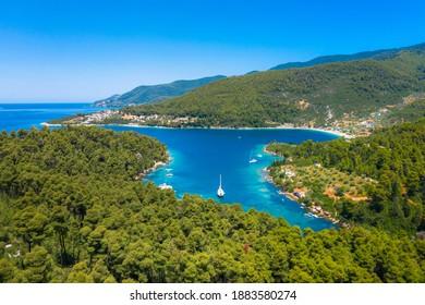 Amazing beach in the fjord blo, near famous beach of Panormos, Skopelos, Greece.