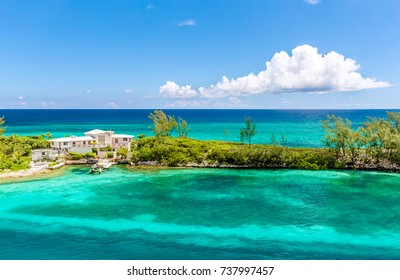 Amazing beach house at Nassau, Bahamas. Paradise island in the island of Nassau, in the heart of the Caribbean sea in a sunny summer day. Caribbean beaches with white sand  and deep blue sea Bahamas.