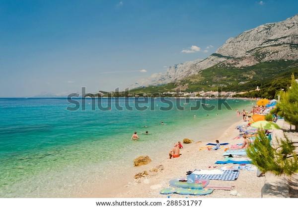 Amazing beach with people in Tucepi, Croatia. Tucepi is a popular holiday resort in Croatia