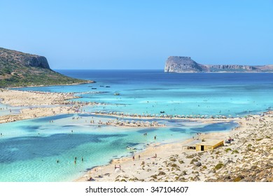 Amazing  beach at the scenery Bay of Balos.The confluence of three seas(Aegean,Adriatic,Libyan).Beautiful beach with clear water with colorful shades of blue and emerald.Crete island.Greece.Europe.