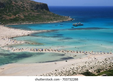 Amazing beach at scenery Bay of Balos. The confluence of three seas(Aegean, Adriatic, Libyan). Beautiful beach with clear water with colorful shades of blue and emerald. Crete island. Greece. Europe.