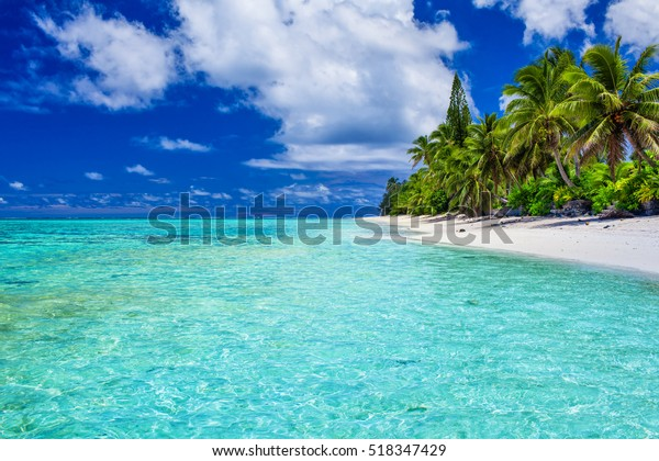 Amazing beach with white sand and palm trees on Rarotonga, Cook Islands