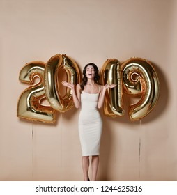 Amazing beautiful excited young brunette womanWith Balloons Celebrating New Year's Eve Party.