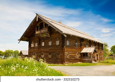 Amazing beautiful unique landscape. Old historical orthodox museum wooden dome church monastery Kizhi. Island Karelia Onega. North country Russia. Green grass in meadow. UNESCO world heritage.