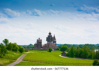 Amazing beautiful unique landscape. Old historical orthodox museum wooden dome church monastery Kizhi. Island Karelia Onega. North country Russia. Green grass in meadow. UNESCO world heritage