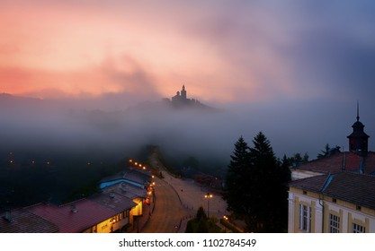 Amazing beautiful view over Tsarevets Fortress in Veliko Tarnovo, Bulgaria on a foggy sunrise in summer.