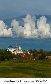 Amazing beautiful white clouds in the blue sky over town Suzdal