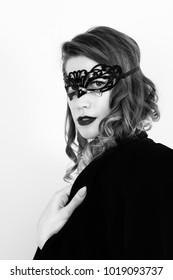 amazing beautiful woman. portrait. carnaval mask, choker, bodysuit, mens jacket, big boobs. bw, black and white photo. retro. 50 shades of grey. isolated.