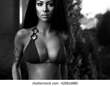 Amazing beauty girl dressed bikini. Black-white outdoor photo.