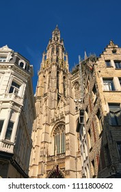 Amazing Bell tower with golden watch of the Cathedral of Our Lady. Tower is the highest in the Benelux.
