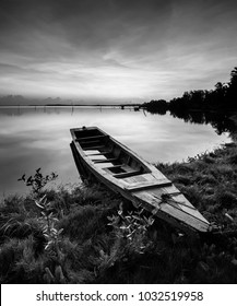 Amazing Black & white scenery of traditional fishing boat at Tumpat, Malaysia with fisherman silhouette standing on the boat. Soft focus due to long exposure.