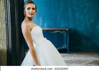 Amazing blonde bride in the loft studio