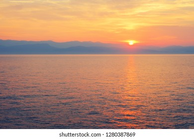Amazing blue Ionian Sea at sunrise in Sidari holiday village on Corfu island in Greece ,Europe