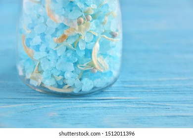 Amazing blue salt in crystal on blurred blue background. Mineral saline sodium chloride. Organic food condiment in salt shaker on blue backdrop. Unusual blue salt for delicious dishes. Selective focus