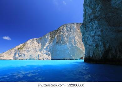 Amazing blue water, ship and steel rocks on a greek island Zante