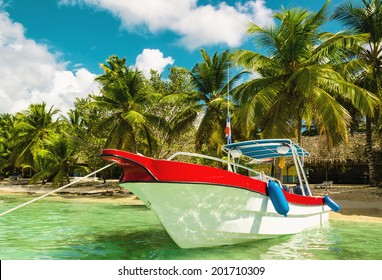 Amazing boat on sandy tropical Caribbean beach